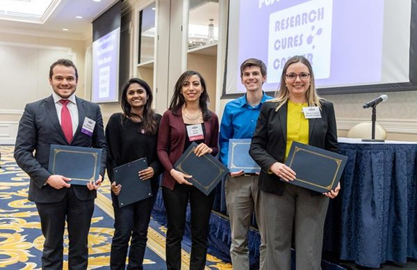 Sandhya Vasudevan with other graduate students with their 3rd place prizes during Harper Research Day